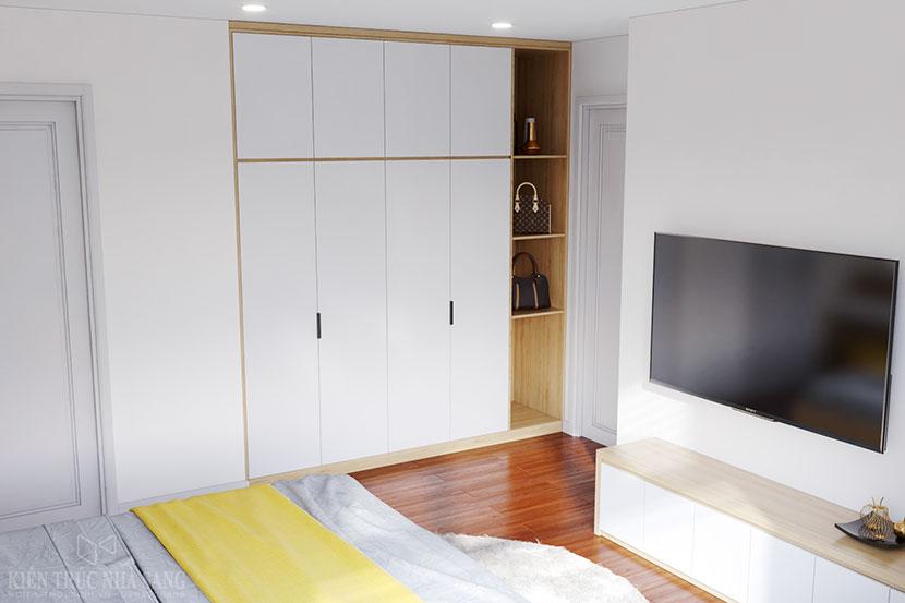 chiếc tủ âm tường tạo cho không gian phòng ngủ méo trở nên vuông vắn hơn